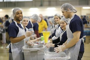 Packaging nonperishable meals for shipping to Liberia are, from left: Carson Long, University of Saint Mary alumnus, class of 2014; and students Jami Lynne, Bailey Mortensen and Sean Santillan.