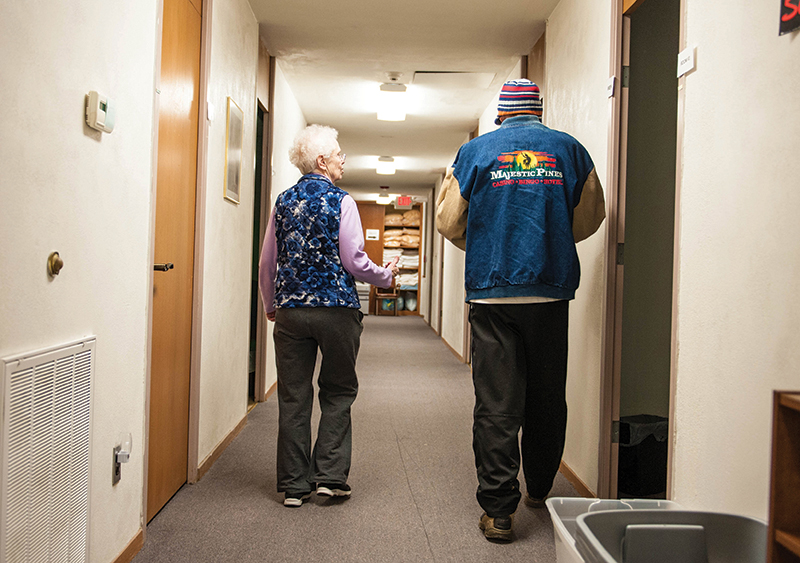 Sister Vickie Perkins, SCL, director of the social service agency Welcome Central, walks a homeless man to his room for the night. Interfaith Shelter of Hope opened on Dec. 15 on the second floor of the Leavenworth Emergency Assistance Center of Catholic Charities of Northeast Kansas, 716 N. 5th St., Leavenworth.