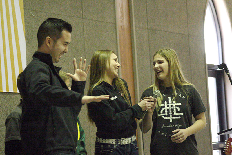 Kim invited Taylor Bittner (center), a sophomore from St. Stanislaus Parish in Rossville, and Nikita Rogers, a freshman from St. Francis Xavier Parish in Burlington, onstage to help make an on-the-spot beatboxing recording using their voices.