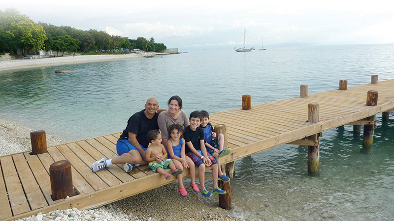 Jacques and Sara Moraille, back row, took their four children, left to right in front, 1-year-old Pierre, 4-year-old Eliana, 9-year-old Joel and 6-year-old Angelo, to Haiti to visit family in November 2014. The family shared their impressions of Haiti with fellow parishioners of Holy Angels Parish in Basehor as the parish raised funds during the Advent and Christmas seasons to provide sturdy houses for families in Haiti.