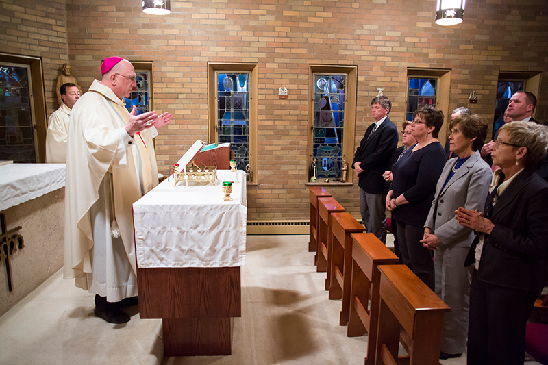 Archbishop Joseph F. Naumann celebrates Mass for high school administrators in his home on Jan. 28. The evening included Mass, dinner and a social hour.