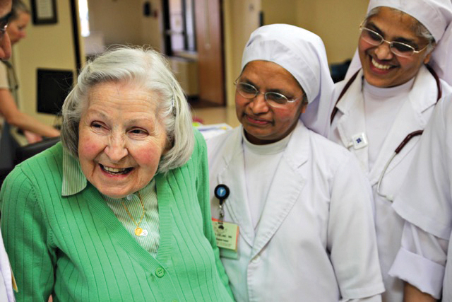 "Sister Lillis, center, and Sister Anne spend some tiem with resident Adele Sykes at Villa St. Francis. ""They're wonderful,"" said one resident. ""The place wouldn't be the same without them."""