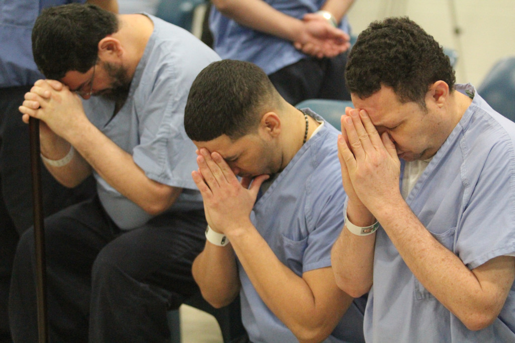 Prison inmates at Curran-Fromhold Correctional Facility in Philadelphia pray during a Mass in mid-January. Pope Francis has a planned visit to the prison Sept. 27 during his two-day visit to the city. (CNS photo/Sarah Webb, CatholicPhilly.com) See POPE-USCUBA and POPE-PHILADELPHIA June 30, 2015.