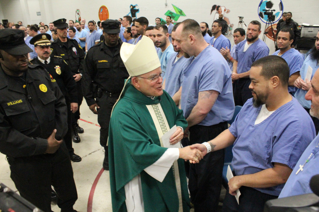 Archbishop Charles J. Chaput of Philadelphia greets inmates of Curran-Fromhold correctional facility in Philadelphia during a visit in mid-January. Pope Francis has a planned visit to the prison Sept. 27 during his two- day visit to the city. (CNS photo/Sarah Webb, CatholicPhilly.com) See POPE-USCUBA and POPE-PHILADELPHIA June 30, 2015.