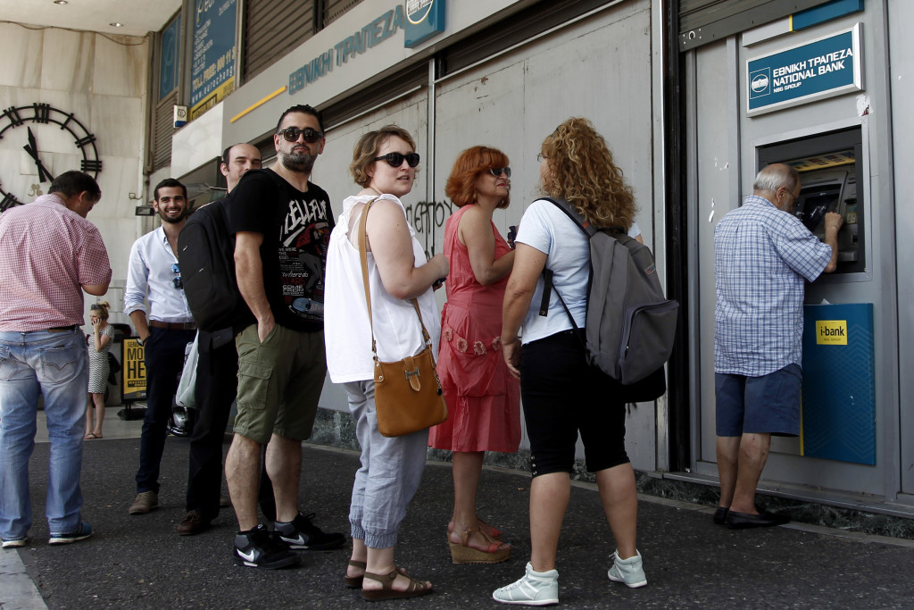 People queue to withdraw money from an ATM outside a branch of Greece's National Bank in Athens, Greece, July 6. (CNS photo/Alexandros Vlachos, EPA) See GREECE-AUSTERITY July 8, 2015.