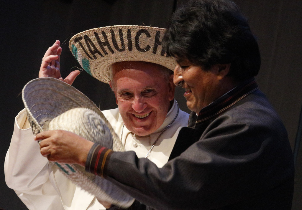 Pope Francis and Bolivian President Evo Morales try on traditional hats as they participate in the second World Meeting of Popular Movements in Santa Cruz, Bolivia, July 9. (CNS photo/Paul Haring) See POPE-POOR July 9, 2015.