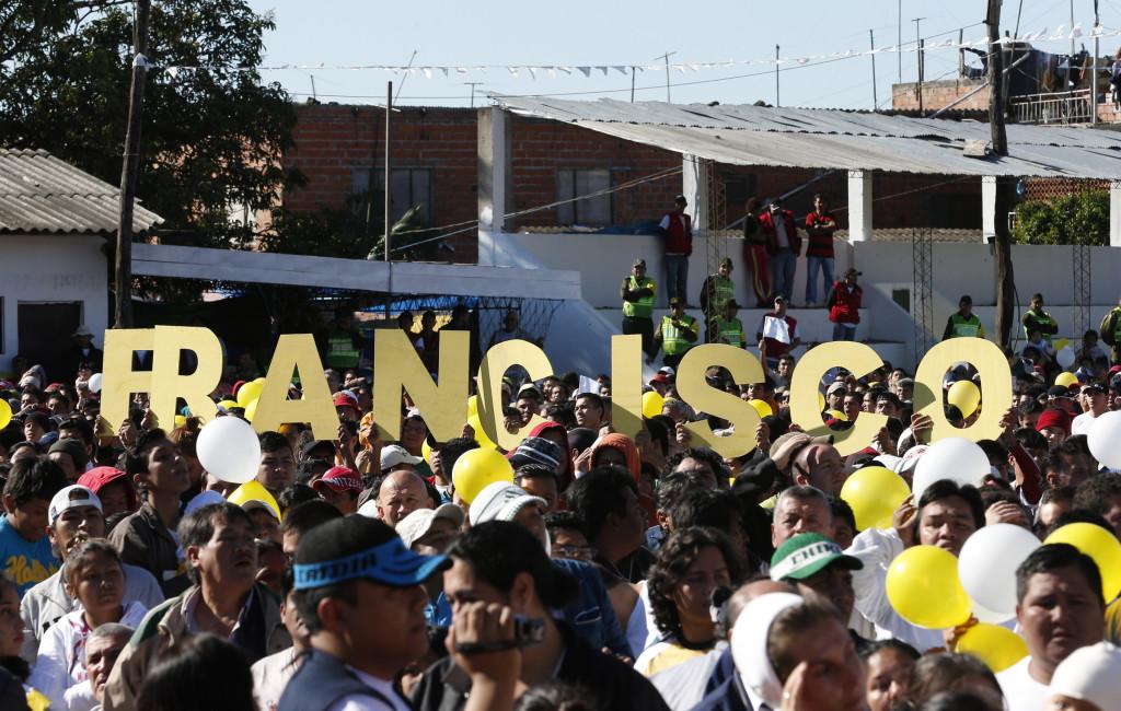 Prisoners and families of inmates in Santa Cruz, Bolivia, await Pope Francis' arrival at Palmasola prison July 10. (CNS photo/Paul Haring)