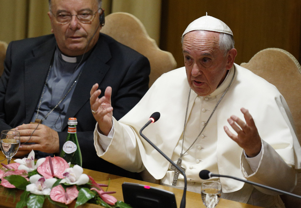 Pope Francis addresses mayors from around the world at a workshop on climate change and human trafficking in the synod hall at the Vatican July 21. Local government leaders were invited by the pontifical academies of sciences and social sciences to sign a declaration recognizing that climate change and extreme poverty are influenced by human activity. Also pictured is Cardinal Francesco Montenegro of Agrigento, Italy. (CNS photo/Paul Haring) See LAUDATO-MAYORS July 21, 2015 and LAUDATO-BROWN July 20, 2015.
