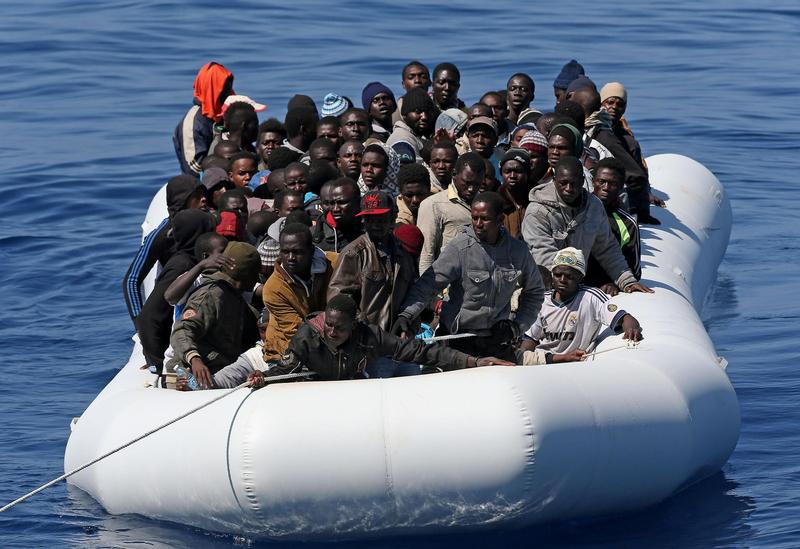 "Migrants are seen in a boat after being rescued in late April in the Mediterranean Sea. Abortion, abandoning migrants at sea, unsafe working conditions, malnutrition, terrorism and euthanasia are all ""attacks on life,"" said Pope Francis. CNS photo/Alessandro Di Meo, EPA"