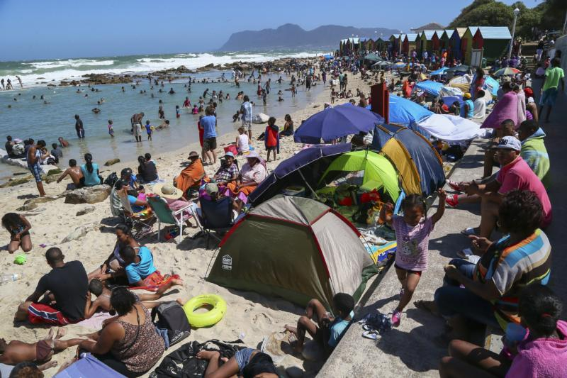 In this 2013 file photo, people spend time on St. James beach in Cape Town, South Africa. (CNS photo/Nic Bothma, EPA) See VATICAN-LETTER-FRANCIS-FAMILIES July 30, 2015.