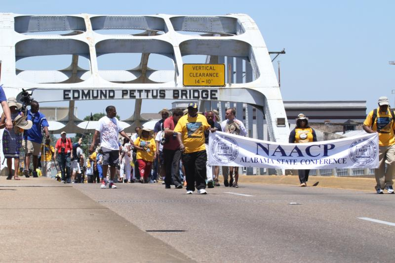"""Marchers leaving Selma, Ala., cross over the Edmund Pettus Bridge Aug. 1 and head to Montgomery, Ala. To mark the 50th anniversary of the Voting Rights Act of 1965, the marchers launched """"America's Journey for Justice,"""" a 860-mile trek to Washington. (CNS photo/Michael Alexander, Georgia Bulletin) See JUSTICE Aug. 4, 2015."""