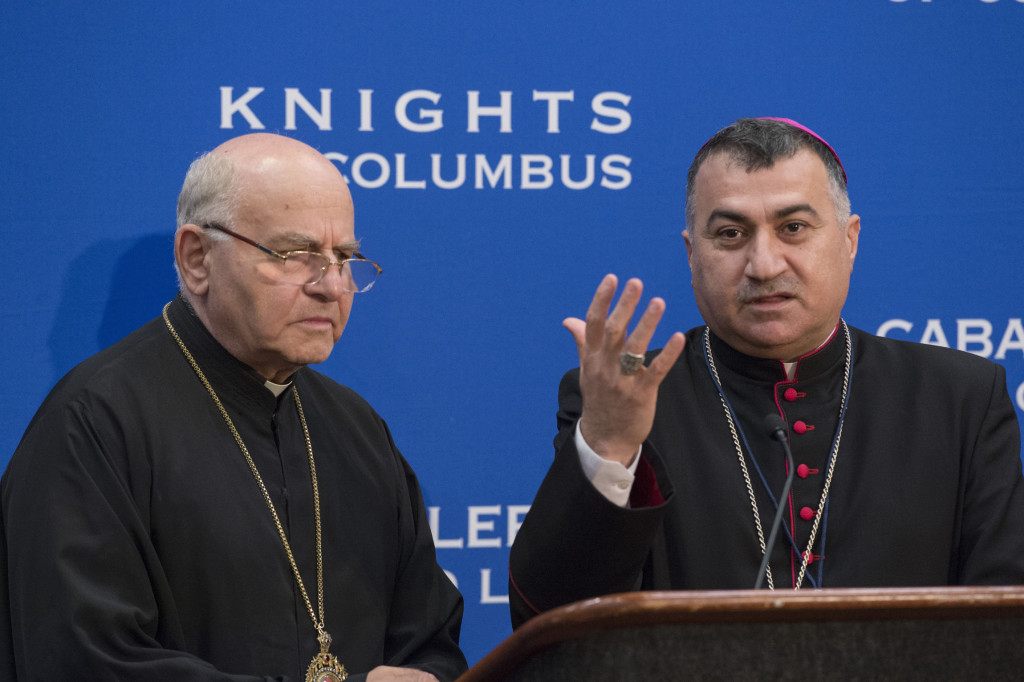 Chaldean Catholic Archbishop Bashar Warda of Irbil, Iraq, gestures alongside Melkite Archbishop Jean-Clement Jeanbart of Aleppo, Syria, during an Aug. 4 news conference at the Knights of Columbus 133rd Supreme Convention in Philadelphia. (CNS photo/Matthew Barrick, Knights of Columbus)