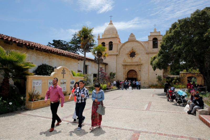 People walk outside San Carlos Borromeo de Carmelo Mission in Carmel, Calif., May 17. As the U.S. Latino Catholic population grows, shared parishes offer Hispanics the best change to influence the church. (CNS photo/Nancy Wiechec)