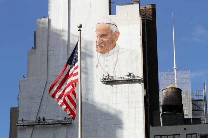 Artists paint an image of Pope Francis on the side of a building in New York City Aug. 27. The mural, which will be 225-feet tall when completed, faces Madison Square Garden, where the pope will celebrate Mass Sept. 25. The artwork was commissioned by DeSales Media Group, the communications and technology arm of the Diocese of Brooklyn, N.Y. (CNS photo/Gregory A. Shemitz)