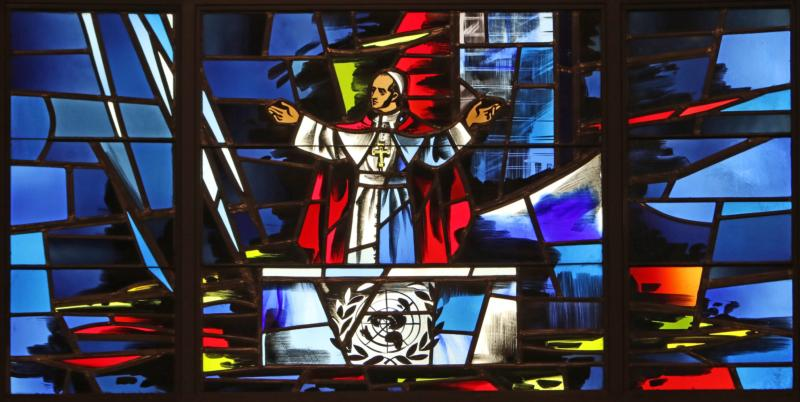 Pope Paul VI's address to the U.N. General Assembly in New York City in 1965 is depicted in a stained-glass window at the Immaculate Conception Center in Douglaston, N.Y. Oct. 4 will mark the 50th anniversary of the speech. Pope Francis will address the General Assembly Sept. 25. (CNS photo/Gregory A. Shemitz)