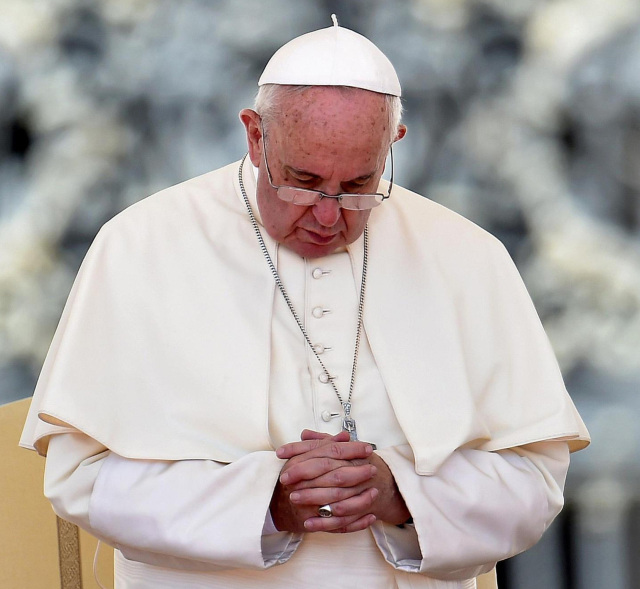 Pope Francis, seen praying during his weekly audience in St. Peter's Square at the Vatican Aug. 26, has issued a letter offering a series of instances in which absolution can be granted during the Year of Mercy. (CNS photo/Ettore Ferrari, EPA)
