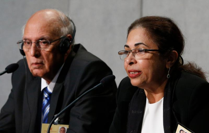 Penny Bajaj, accompanied by her husband Ishwar, speaks during a press briefing after the morning session of the Syond of Bishops on the family at the Vatican Oct. 12. The couple from Mumbai, India, are observers at the synod. (CNS/Paul Haring)