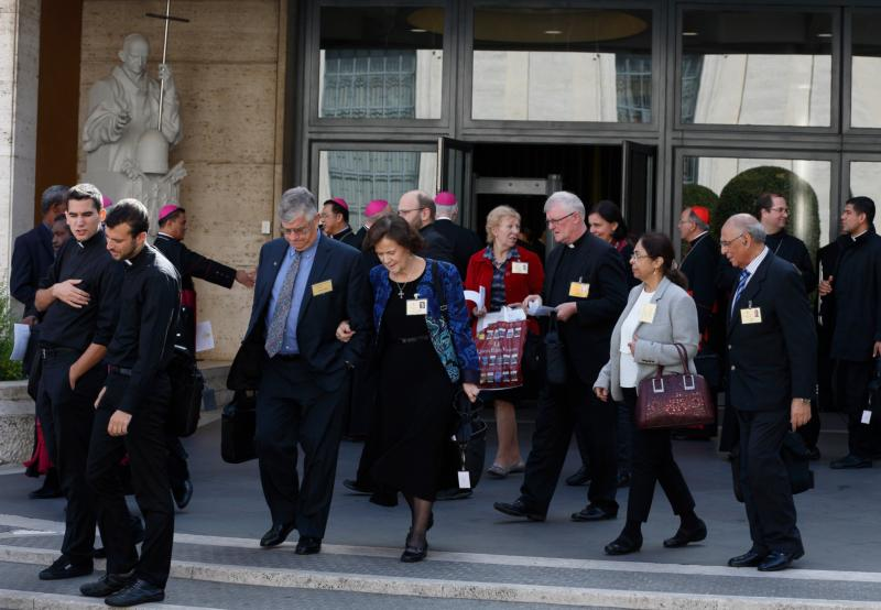 U.S. couple Anthony Paul and Catherine Wally Witczak, center, and other delegates leave a session of the Synod of Bishops on the family at the Vatican Oct. 15. The couple are observers at the synod. (CNS photo/Paul Haring)