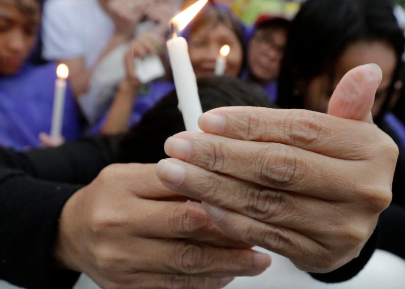 People hold candles during a Mass celebrated by Pope Francis in Manila, Philippines, Jan. 18. Members of the Synod of Bishops on the family don't agree on church vision and its primary attitude to the world. (CNS photo/Francis R. Malaise, EPA)