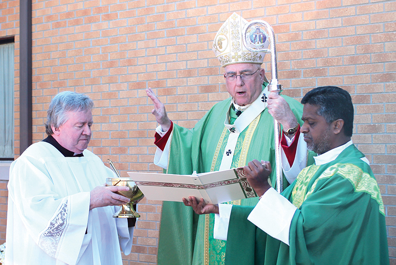 Leaven photo by Marc Anderson Father Marianand Mendem, pastor of St. Francis Xavier Parish in Mayetta, and Archbishop Joseph F. Naumann celebrate the parish's centennial Mass on Oct. 6. Father Mendem was also installed as pastor earlier that day.