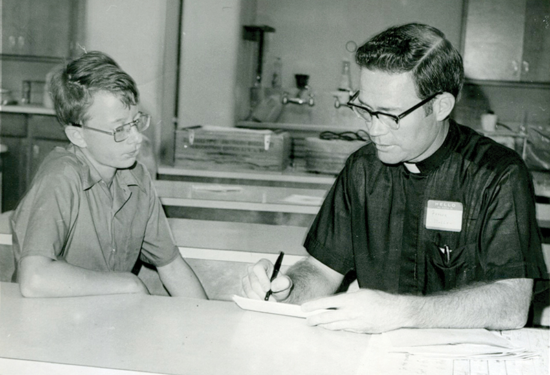 Leaven file photo Msgr. Michael Mullen, a former instructor at Savior of the World Seminary, talks with Chris Towle in 1975 for SemWeek, a time set aside in the summer for grade school boys to spend time at the seminary and get to know archdiocesan priests and seminarians.