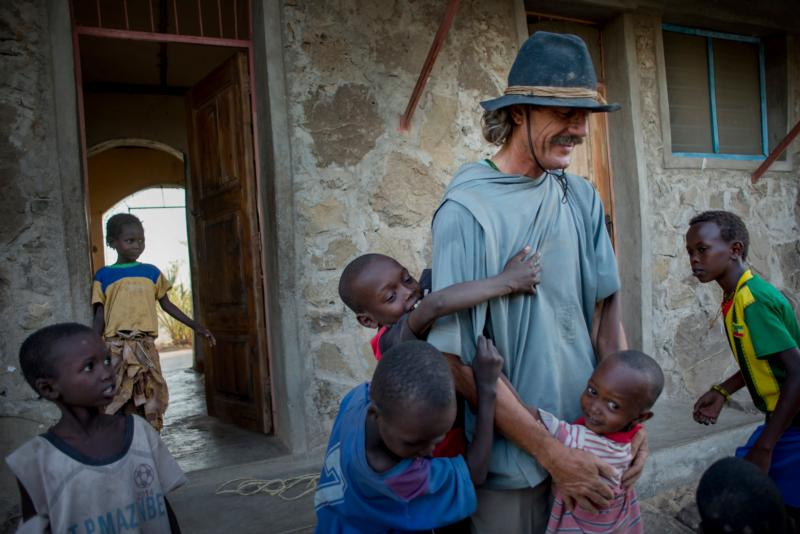 Benedictine Father Florian is greeted by children in early August after returning to Illeret, Kenya, from a trip to Nairobi. The Bavarian prince gave up his inheritance to become a Benedictine monk. (CNS/Christena Dowsett)