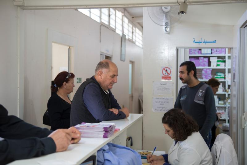 Iraqi refugee Wissam, 60, center, waits for his turn Nov. 18 at St. Anthony's medical dispensary in Beirut. The clinic, run by the Good Shepherd Sisters, functions as a primary health care center, serving Iraqi and Syrian refugees, as well as Lebanon's poor. (CNS photo/Dalia Khamissy)