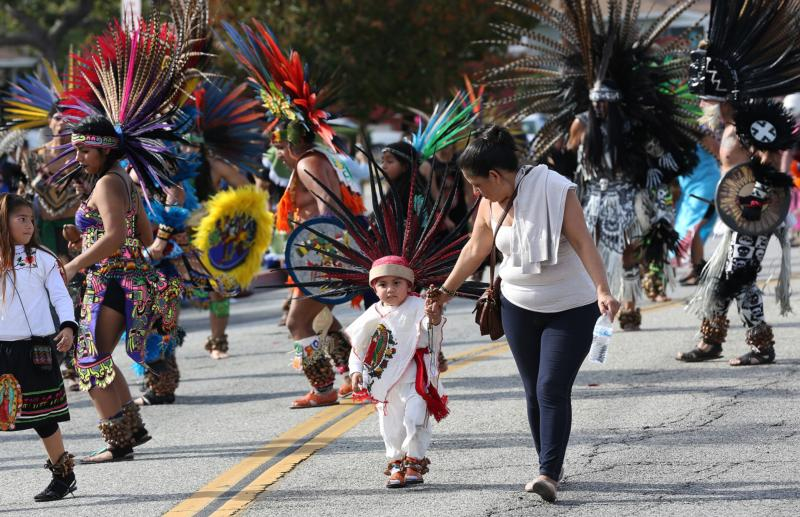 A boy walks with a woman as thousands march in Los Angeles Dec. 6 in the 84th annual procession and Mass in honor of Our Lady of Guadalupe. The feast of Our Lady of Guadalupe is Dec. 12. (CNS photo/Victor Aleman, Vida-Nueva.com)