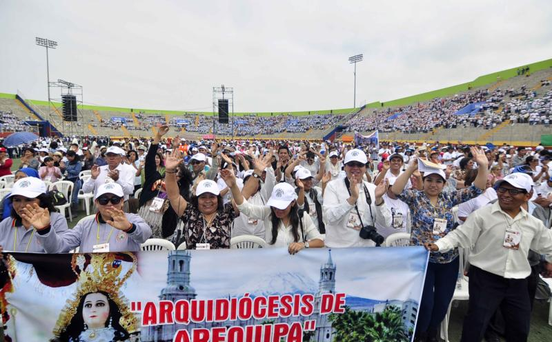 Pilgrims attend the Dec. 5 beatification Mass of Polish Conventual Franciscan Fathers Michal Tomaszek, Zbigniew Strzalkowski and Italian Father Alessandro Dordi, at Chimbote stadium in Peru. The three priests were killed by insurgents in Peru in 1991. (CNS photo/EPA)
