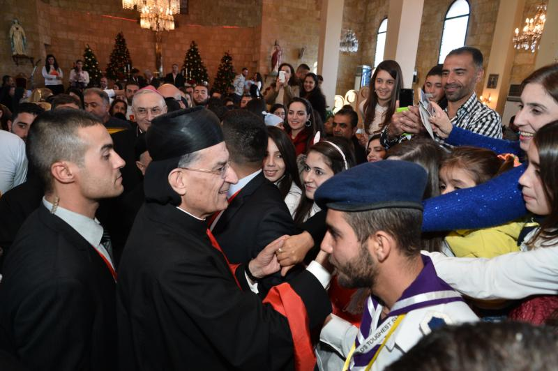 Lebanese Cardinal Bechara Rai, patriarch of the Maronite Catholic Church, greets people after celebrating Mass Dec. 7 at Our Lady of the Annunciation Cathedral in Tartus, Syria.  He urged Syrian Christians to hold onto their faith amid the country's conflict, now in its fifth year. (CNS photo/Mychel Akl for Bkerke, Maronite patriarchate)