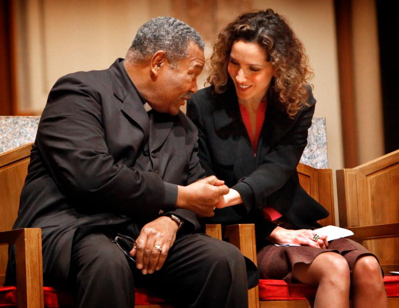 Shayda Safapour of the Baha'i community greets the Rev. B. Herbert Martin, pastor of Chicago's Progressive Community Church, following his sermon at an interfaith prayer service at Holy Name Cathedral in Dec. 8. The service was organized to pray for peace and show solidarity for the city of Chicago and against violence in the city. (CNS photo/Karen Callaway, Catholic New World)