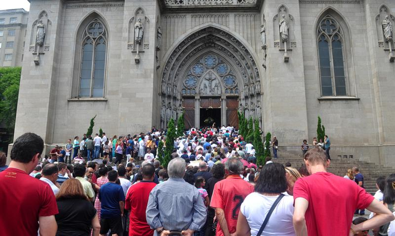 People wait for Sao Paulo Cardinal Odilo Scherer to open the Door of Mercy Dec. 13 at the city's cathedral for the Jubilee of Mercy. (CNS photo/Luciney Martins, courtesy O Sao Paulo)