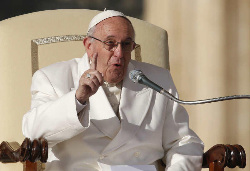 Pope Francis speaks during his general audience in St. Peter's Square at the Vatican Dec. 16. (CNS photo/Paul Haring)