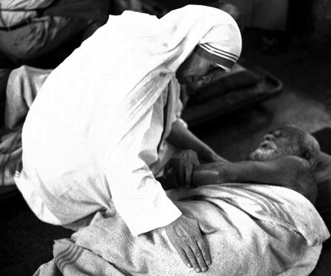 Pope Francis has approved a miracle attributed to the intercession of Blessed Teresa of Kolkata, thus paving the way for her canonization. She is pictured with an ailing man in an undated photo. (CNS photo courtesy Catholic Press Photo)