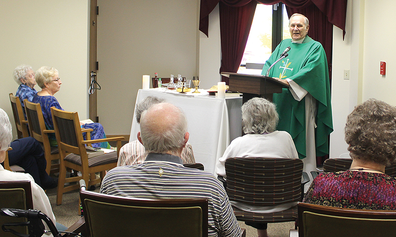 leaven photo by marc anderson Father Tom Hesse celebrates Mass for Topeka's Atria Hearthstone Community, one of the many efforts of Most Pure Heart of Mary Parish's ministry to the aging.