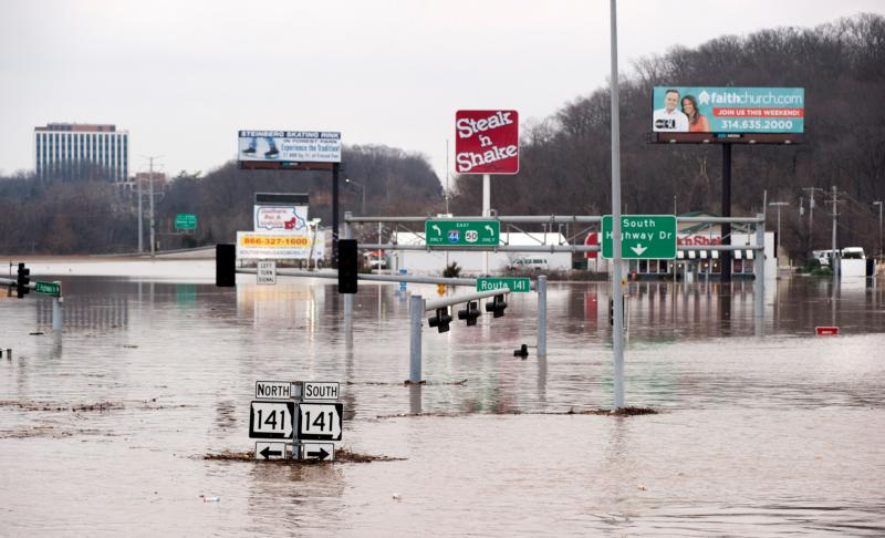 Floodwaters from the nearby Meramec River fill the traffic lanes of I-44 and Missouri Route 141 Dec. 30 in Valley Park, just outside St. Louis. Pope Francis called on Christians to pray for victims of several natural disasters that have hit parts of the United States, Great Britain and Paraguay. (CNS photo/Sid Hastings, EPA)