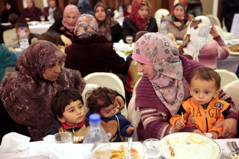Evacuees from besieged towns in Syria rest at Ebla Hotel in Damascus Dec. 30. (CNS photo/Youssef Badawi, EPA)