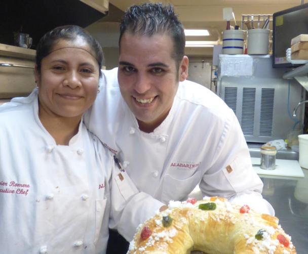 Margarita Castillo, chief pastry chef at Washington's Taberna del Alabardero, and Javier Romero, executive chef, display a finished roscon de reyes, a cake traditionally savored during the Epiphany in Mexico and Spain. The cake is similar to the king cake, but is starting to appear more often in January at the tables of immigrants living in the U.S. (CNS photo/Rhina Guidos)