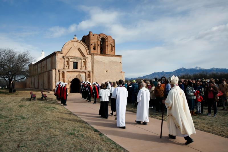 Bishop Gerald Kicanas of Tucson, Ariz., walks in procession to celebrate Mass outside the mission at Tumacacori National Historical Park in Tumacacori, Ariz., Jan. 10. The Mass was part of the park's Kino Legacy Day marking the 325th anniversary of the Jesuit missionary's first visit to an O'odham village there. (CNS photo/Nancy Wiechec)