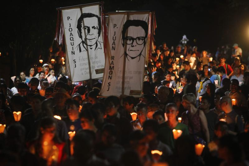 "People participate in the ""little lanterns march"" at the Central American University in San Salvador during the 2015 commemoration of the 26th anniversary of the massacre of six Jesuit priests and two women, murdered in November 1989 by a military commando. (CNS photo/Oscar Rivera, EPA) See SALVADOR-SPAIN-EXTRADITION-JESUITS Jan. 12, 2016."