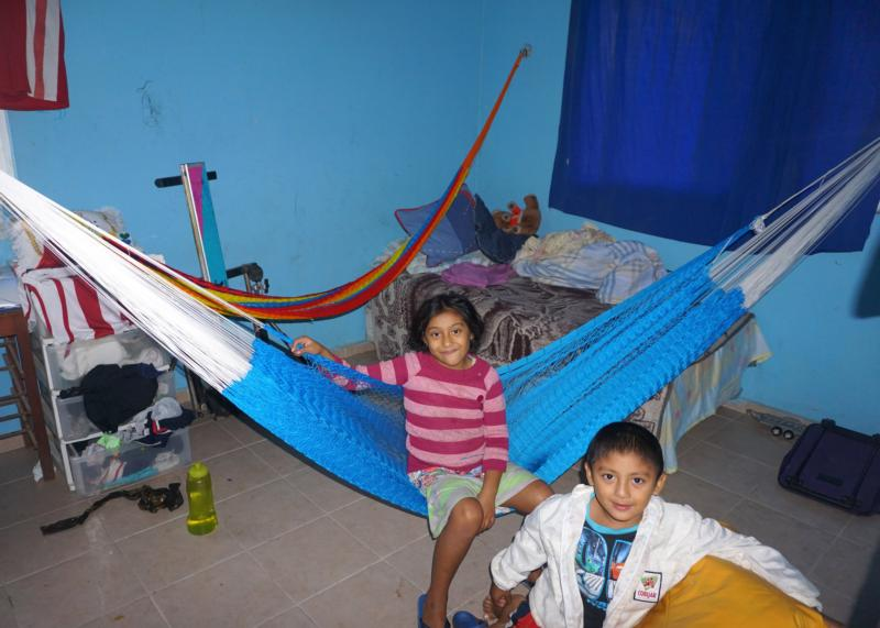 Paulina Gongora Chim, 7, and Elias Chin, 5, pose for a photo at Oasis San Juan de Dios in Conkal, Mexico, Jan. 5. They live at the shelter because their mothers have HIV. (CNS photo/Alicia Cabezas)