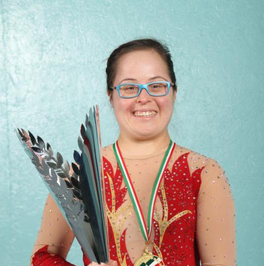 Lani DeMello, 30, pictured in a Dec. 8 photo, earned the title of World Champion in Rhythmic Gymnastics at the Down Syndrome International Gymnastics World Championships in Mortara, Italy. DeMello, a parishioner at Holy Trinity Church in Peachtree City, Ga., earned a silver medal performing with the ribbon in the event. (CNS photo/ Michael Alexander, Georgia Bulletin)