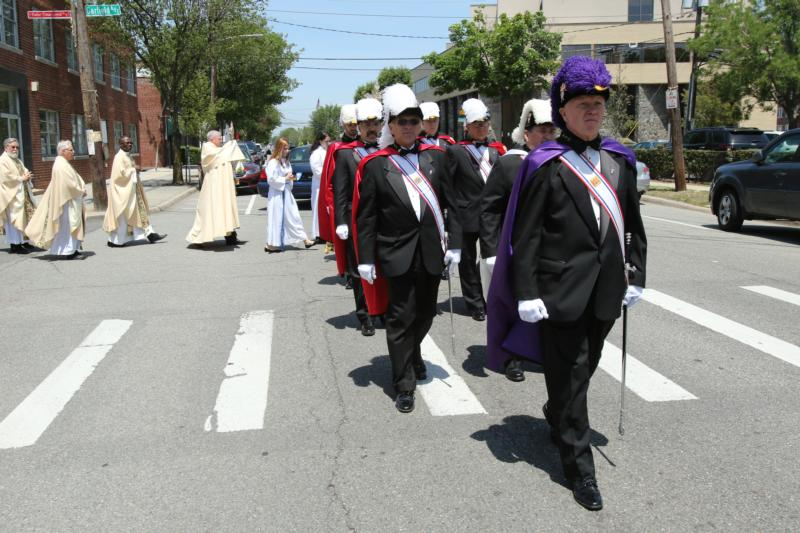 A Knights of Columbus honor guard leads a eucharistic procession on the feast of Corpus Christi in Corpus Christi Parish in Mineola, N.Y. (CNS photo/Gregory A. Shemitz)