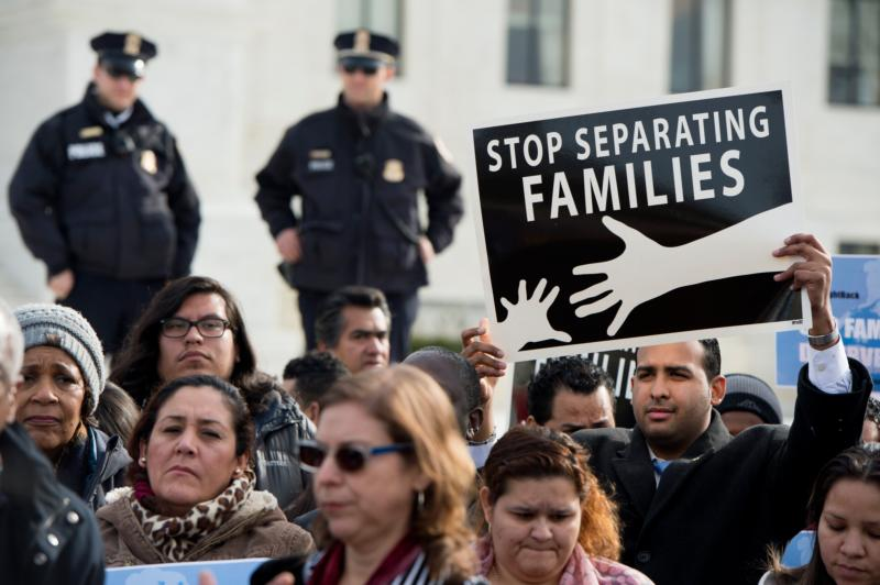 A man displays a sign as immigration advocates rally outside the U.S. Supreme Court Jan. 15 in Washington. The Supreme Court Jan. 19 agreed to review President Barack Obama's executive actions to protect from deportation both those who came to the U.S. as children and the immigrant parents of children who are U.S. citizens or legal residents of this country. (CNS photo/Michael Reynolds, EPA)