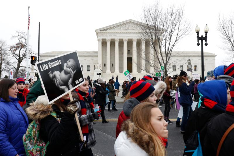 Pro-life advocates walk past the Supreme Court building during the March for Life in Washington Jan. 22, the 43rd anniversary of the Supreme Court's Roe v. Wade decision legalizing abortion in U.S. (CNS photo/Gregory A. Shemitz)