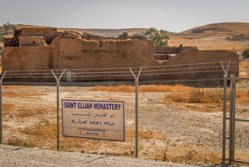 A fence surrounds the remains of St. Elijah Monastery in 2009 in Mosul, Iraq. Islamic State militants claimed responsibility for the recent destruction of Iraq's oldest Christian monastery after a preservation effort was mounted to save the 1,400-year-old site. (CNS photo/courtesy Father Jeffrey Whorton)