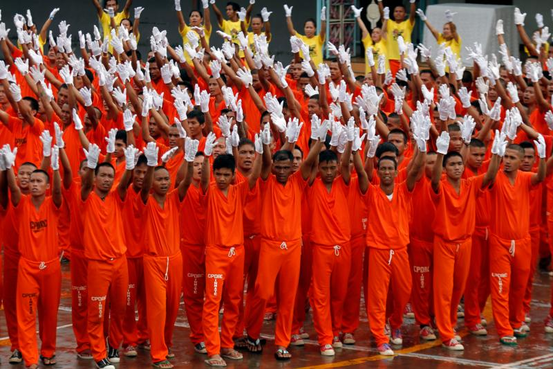 The famous dancing inmates of the Cebu Provincial Detention and Rehabilitation Center in the Philippines perform during the visit of Cardinal Charles Maung Bo of Yangon, Myanmar, at the facility. The cardinal was in the Philippines for the 51st International Eucharistic Congress. (CNS photo/Jay Rommel Labra, EPA)