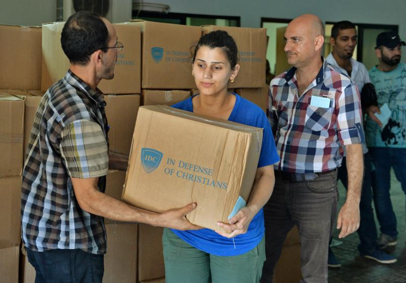 An Iraqi Chaldean Catholic receives humanitarian aid in 2015 in Beirut. Iraq's Chaldean Catholic patriarch said increasing incidents of discrimination against Christians in Iraqi society were inciting fear and causing an exodus of Christians from their homeland. (CNS photo/Wael hamzeh, EPA)