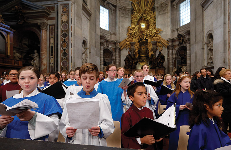 "The childrenís choir from Most Pure Heart of Mary Church in Topeka, Kan., sings ""Adeste Fideles"" as Pope Francis concludes Mass marking the feast of the Epiphany in St. Peter's Basilica at the Vatican Jan. 6. (CNS photo/Paul Haring) See POPE-EPIPHANY Jan. 6, 2015."