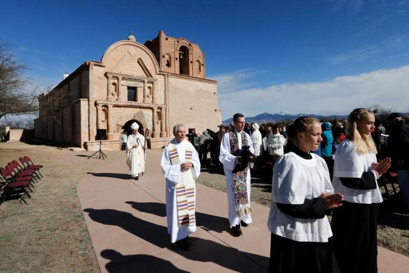 After celebrating Mass Bishop Gerald Kicanas of Tucson, Ariz., walks with his crosier outside the mission at Tumacacori National Historical Park in Tumacacori, Ariz., Jan. 10. The Mass was part of the park's Kino Legacy Day marking the 325th anniversary of the Jesuit missionary's first visit to an O'odham village there. (CNS photo/Nancy Wiechec)